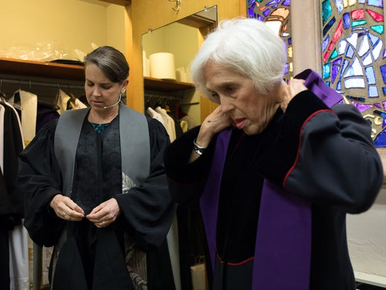 Pamela Dykehouse pastor of the First United Methodist Church in Corpus Christi puts on her robe before service on Feb. 25.