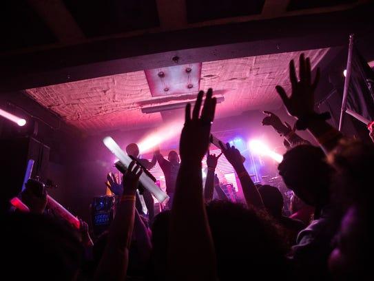 Audience members dance during El Dusty's Tropicoso