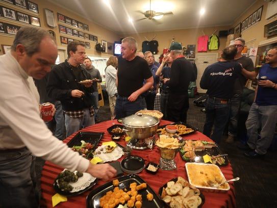 Competitors eat and drink in the so-called warm room