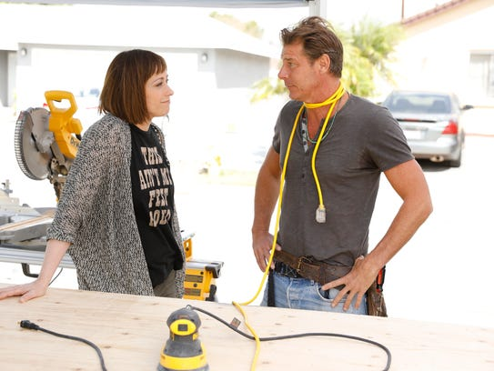 Paige Davis and Ty Pennington on the job in TLC's revival