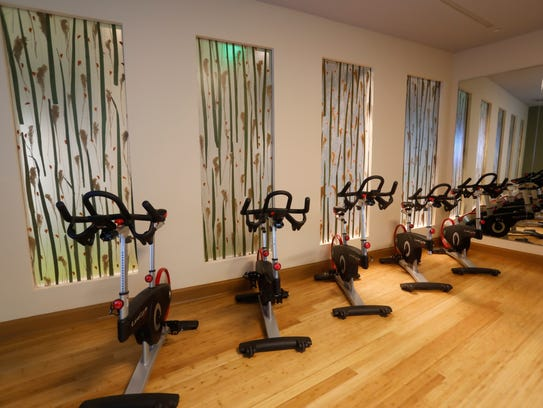 The gym room offers free weights, cycling, treadmills