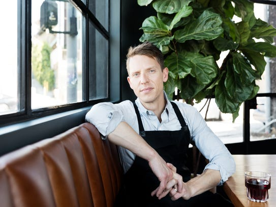Zach Pollack sits inside his eatery Cosa Buona, which