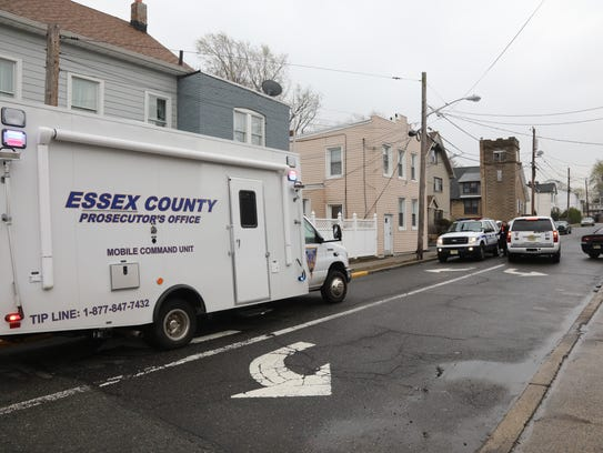 The Essex County Prosecutors's Office investigates a homicide that occurred on Bloomfield Avenue near Hartley Street.