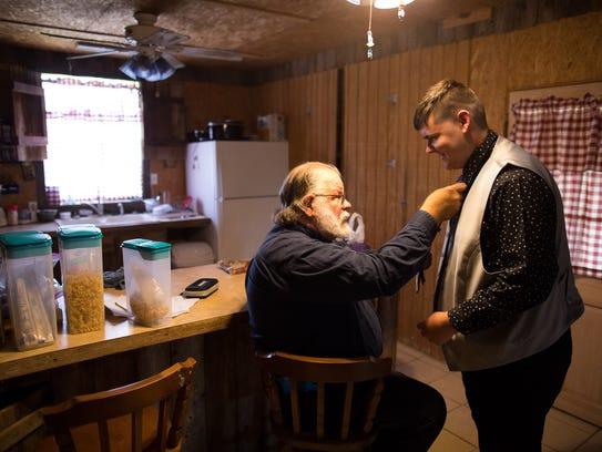 Family friend Larry Peterson helps Rockport-Fulton