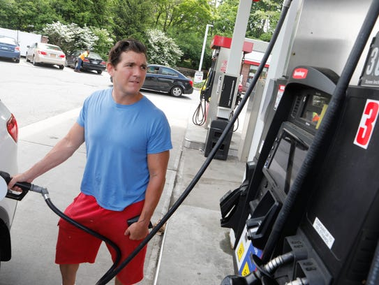 James Powers of Tarrytown gases up his car for the