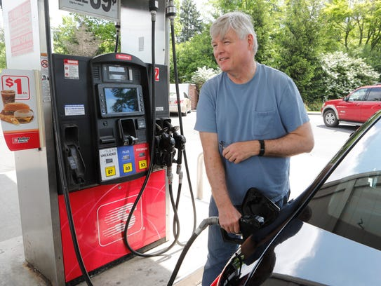 Peter Smyth of Tarrytown gases up his car for the weekend