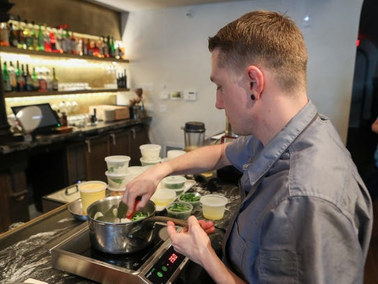 Justin Uchtman, executive chef at Sartre OTR, prepares