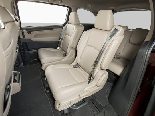 Honda hopes clever seats that slide apart will sell new for Honda odyssey magic seat