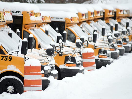 Snow-covered school buses are parked in the yard near Arthur S. May School on Monday in the Town of Poughkeepsie.