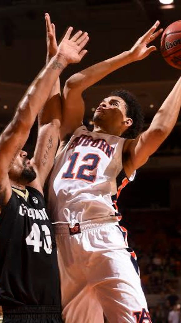 Tyler Harris (12) going up for a layup vs. Colorado