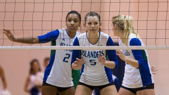 Texas A&M-Corpus Christi junior Brittany Gilpin (left) switched from middle blocker to outside hitter and shined, earning the program's first Southland Conference Player of the Year honor.