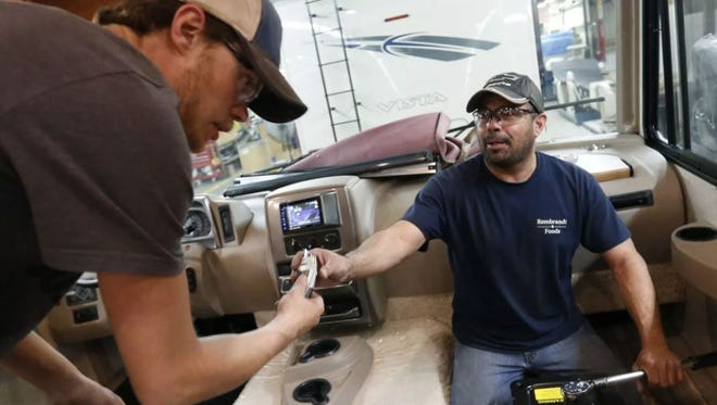 Working together on the interior of a motorhome