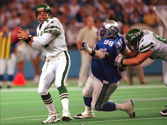 Cortez Kennedy chases down New York Jets quarterback Neil O'Donnell during a game in 1997.