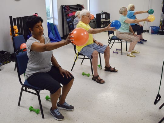 """""""I love the fellowship,"""" said Barbara Williams, 69, who enjoys the interaction with others in the Chair Aerobics class at the Turner Street YWCA. The class uses small rubber balls in the workout which strengthen fingers."""