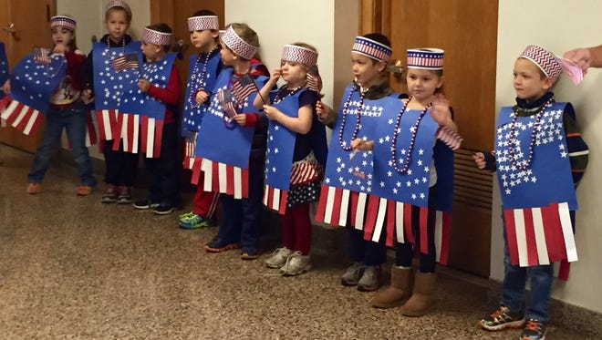 Kindergartners wear patriotic outfits at 2014 tribute to military at Center Street Elementary School in Horseheads.