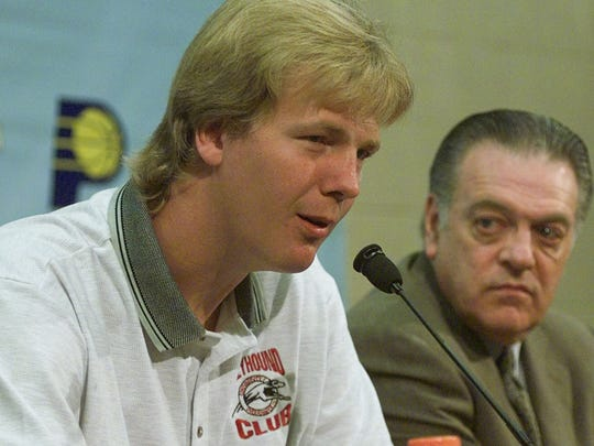 Indiana Pacers 7-foot-4 center Rik Smits announced his retirement after 12 years in the NBA at a news conference in Indianapolis Wednesday, Sept. 27, 2000, with Pacers president Donnie Walsh, right. Smits said foot and knee injuries led to his decision. (AP Photo/Chuck Robinson)