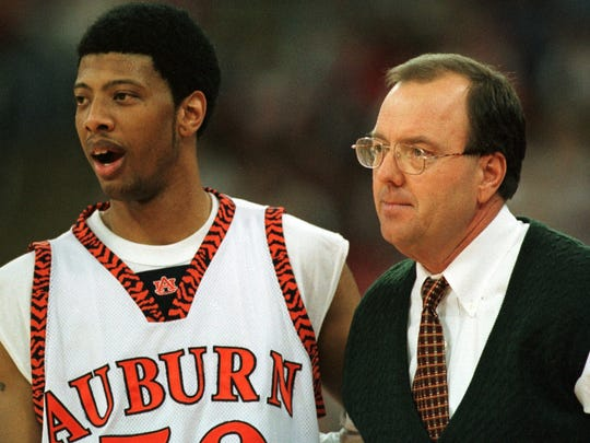 Auburn's Doc Robinson (50) and Coach Cliff Ellis watch