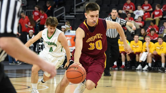Roosevelt's #30 Tristan Teichmeier drives down the court against Pierre's #11 Nealy Pokorny during state basketball action at Denny Sanford Premier Center in Sioux Falls, S.D. Thursday, March 17, 2016.