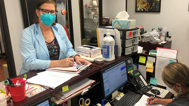 Dr. Erica Swegler, a primary care doctor in solo practice in Austin, Texas, left, and Berlinda Olivo, a nurse in her clinic, saw visits from patients decline 70 percent. Swegler, like many primary care physicians, is facing deep financial strain as a result of the pandemic.