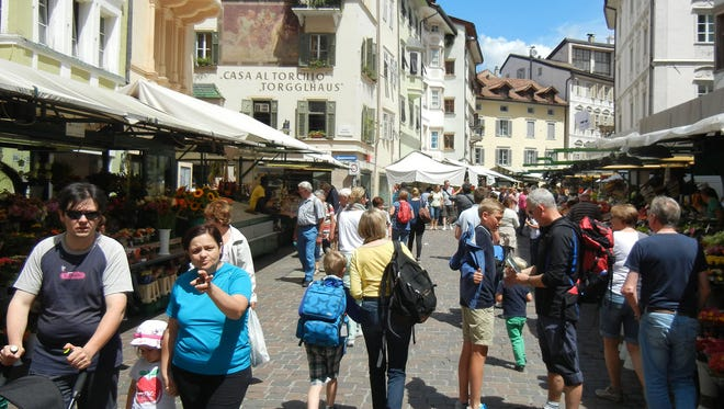 With flower-bedecked windows and a buzzing produce market, Bolzano feels equally Austrian and Italian.