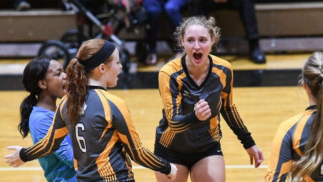 Crescent sophomore Mackenzie Hayes(11), right, and teammate sophomore Emily Stewart(6) celebrate a point against Pendleton during the third set at Pendleton High School in Pendleton on Thursday. Crescent won in three sets, 25-15, 25-13, and 25-18.