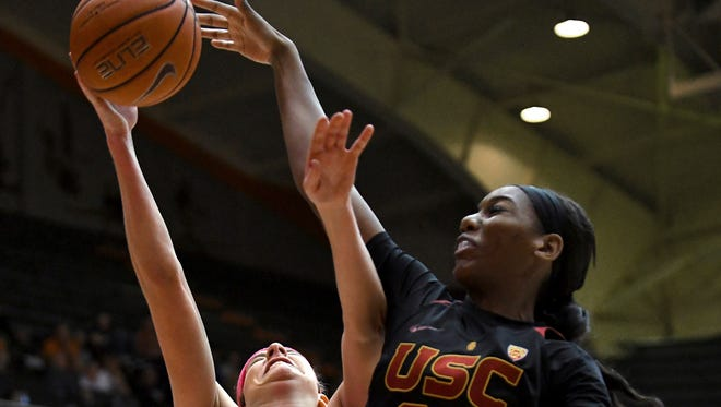 Oregon State guard Sydney Wiese (24) is blocked by Southern California forward Asiah Jones (23) during the first half of an NCAA college basketball game Friday, Feb. 10, 2017, in Corvallis, Ore.