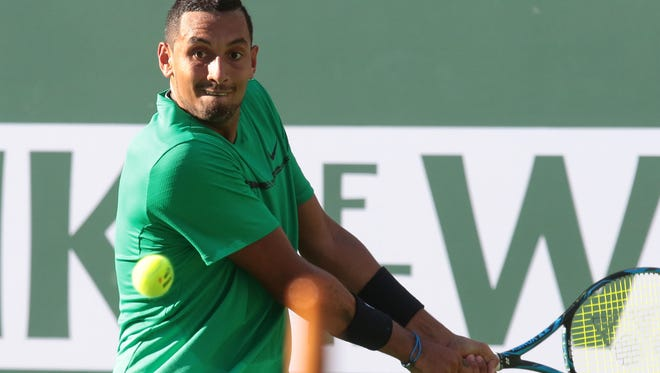 Nick Kyrgios, of Australia, returns the ball to Novak Djokovic, of Serbia, in the men's 4th round at the BNP Paribas Open in Indian Wells, CA Wednesday, March 15, 2017.