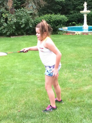 Mia Lucksted of Farmington tries her hand at badminton during on the mansion grounds.