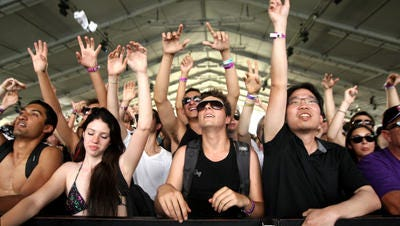 Fans react to a performance in the Gobi Tent