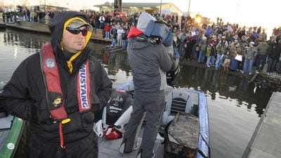 While throngs of fishing fans watch from the bank, Louisiana's Greg Hackney prepares to launch in the 2009 Bassmaster Classic at the Red River South Marina.