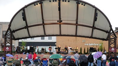 Johnny Altenburgh & The Mo-Tones play at a Concerts on the Square performance by in downtown Wausau in 2011. This week marks the start of summer festivals and events.