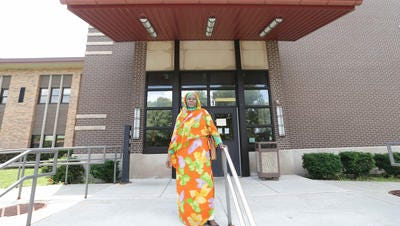 Parents Involvement Educator Mastora Bakhiet stands in front of the Enlace Academy building, where Indianapolis Public Schools will be starting a newcomer program housed in the Enlace Academy, Thursday June 23rd, 2016. Bakhiet is a refugee herself from Darfur.