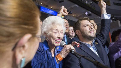 Jerry Emmett, the 102-year-old honorary chair of the Arizona Democratic delegation, speaks during the Roll Call of the States while state delegate Rep. Ruben Gallego, D-Ariz., and the rest of the delegation cheer at the Democratic National Convention in Philadelphia on Tuesday, July 26, 2016.