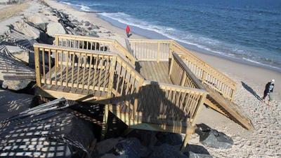 Recent winter storms have broken away the stairway at Karge Street that crossed the sea wall in Bay Head. This view on Monday, February 6, 2017, looks north from there.