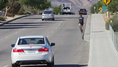 Traffic moves along Fred Waring Drive at the Whitewater Wash in Indian Wells. The city is in the early stages of building a bridge over the wash and funding efforts will be discussed Monday at the Coachella Valley Association of Governments' Transportation Committee meeting.