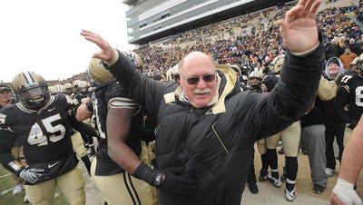 Former Purdue head coach and MSU star Joe Tiller celebrates a 62-10 victory over Indiana in 2008 at Ross-Ade Stadium in West Lafayette, Ind. Tiller passed away Saturday at 74.