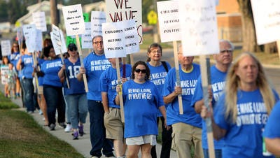 Caseworkers with the Butler County Children's Services strike outside of the services building on Monday morning.