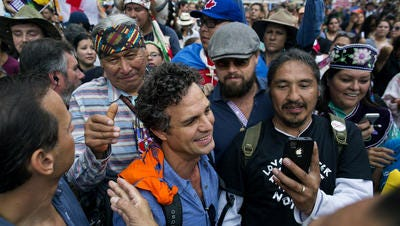 Actor and activist Mark Ruffalo, center left, and actor Leonardo DiCaprio, center right, join participants during the People's Climate March in New York Sunday, Sept. 21, 2014. Thousands of demonstrators filled the streets of Manhattan on Sunday, accompanied by drumbeats, wearing costumes and carrying signs as they urged policy makers to take global action on climate change.