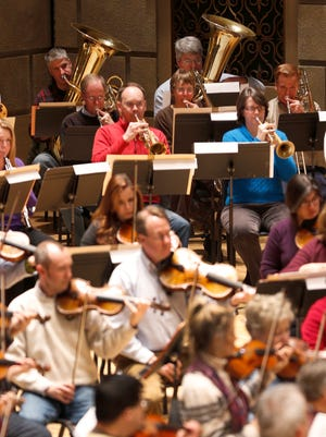 """Amateur musicians, including Scott Kesel (back right) on tuba, rehearse for the 2014 """"Side by Side"""" concert. The program is repeating this year."""