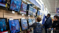Shoppers pick out TVs to give for the holidays.