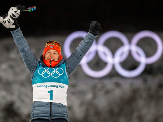 Gold Medalist Laura Dahlmeier, of Germany, celebrates during the venue ceremony at the women's 10-kilometer biathlon pursuit at the 2018 Winter Olympics in Pyeongchang, South Korea, Monday, Feb. 12, 2018. (AP Photo/Andrew Medichini)