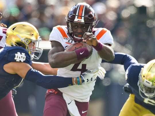 Nov 2, 2019; South Bend, IN, USA; Virginia Tech Hokies quarterback Quincy Patterson (4) runs the ball in the first quarter against the Notre Dame Fighting Irish at Notre Dame Stadium. Mandatory Credit: Matt Cashore-USA TODAY Sports
