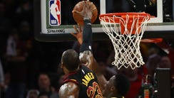 LeBron James #23 of the Cleveland Cavaliers blocks