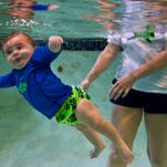 Kruz Franzke, 7 months, learns to hold his breath under water under the guidance of Kathy Cole, an ISR Master Instructor (Infant Swimming Resource) during an infant self-rescue class Thursday morning (7/23/15) taught by Cole in the pool at Scubavice Dive Center in Fort Myers.  The babies were also learning the skill of self-rescue which involves rotating their bodies in order to float and breath above water.