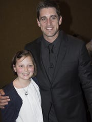 Aaron Rodgers smiles with Maggie, who has battled leukemia.