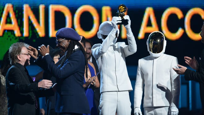 Thomas Bangalter and Guy-Manuel De Homem-Christo of Daft Punk accept the album of the year award at the 56th Annual Grammy Awards at the Staples Center in Los Angeles on Sunday.