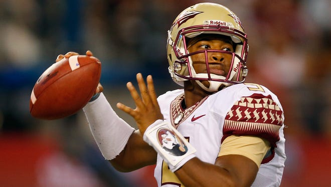 Jameis Winston (5) wearing Florida State's new uniform and helmet in the Seminoles' season opening game against Oklahoma State.