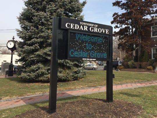 "A ""Welcome to Cedar Grove"" sign."