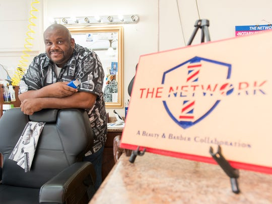 Owner Floyd Jones poses at The Network Beauty & Barbershop in Brownsville on Thursday, November 16, 2017.