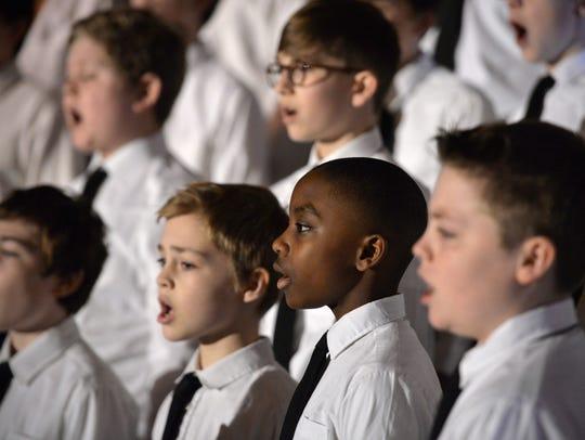 The St. John's Boys Choir sings during Monday's Third